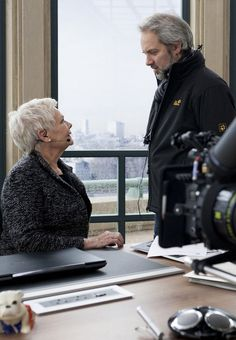 """Judi Dench and Sam Mendes on the set of """"Skyfall"""" (2012)"""