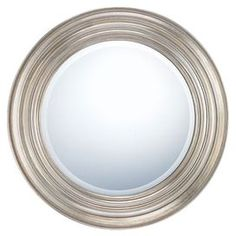 "Beveled wall mirror framed in antiqued silver.  Product: Mirror  Construction Material: Resin and mirrored glass  Color: Antiqued silver   Features:  Contemporary style  Perfect in bathroom, bedroom, foyers or hallways    Dimensions: 30"" Diameter"