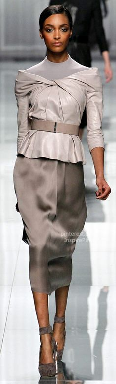 Dior.  Love the monochromatic color scheme.  The top is fantastic and the contrast of the leather with the flow of the skirt is a great combination.