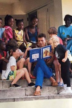 This is an incredible picture, David reading to children just shows me what a giving man he was.