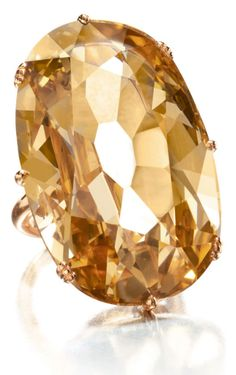 A 49.31ct, Mughal-cut golden Golconda diamond ring, set into a simple contemporary mount called the 'Maharaja Sunset', by Siegelson. Via The Jewellery Editor.