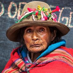 A woman selling produce at the market in the Sacred Valley town of Ollantaytambo, Peru. Bolivia, First Humans, Face Design, Interesting Faces, World Cultures, People Around The World, Human Rights, Hats For Women, Beautiful People