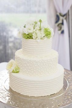 TONE ON TONE: The stripes and dotted designs throughout the wedding took a subtle turn when iced in white on the wedding cake by Fish Restaurant.