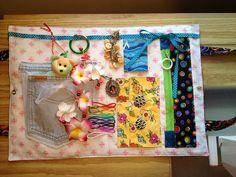 Closed up, it looks like a purse/bag. Susan's Quilt Creations: Alzheimer Fidget Fun Mats