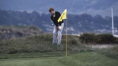 """The 1982 U.S. Open at Pebble Beach. Tied with Jack Nicklaus, the clubhouse leader, Tom Watson played his approach to the 17th hole into thick rough to the left of the green. Playing onto a downhill lie, caddy Bruce Edwards urged Watson to try and get close. Watson's reply is part of golfing history.    """"Close, hell. I'm going to sink it""""    He did, and with a birdie at 18 he secured a 2 shot victory."""