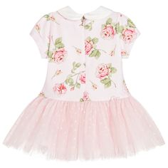 Baby girls pretty pink dress by Monnalisa Bebé, with a green and pink floral pattern on the jersey bodice. The bodice has a shiny satin collar and a concealed zip fastener at the back. Below the dropped waist, the full gathered skirt has layers of spotty tulle and a soft cotton lining.