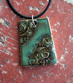 Brown+and+Green+Rustic+Swirls+Porcelain+Pendant+by+muddyfingers