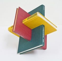 Gareth Spor's book sculptures are created by cutting and reassembling old books into various geometric forms. More