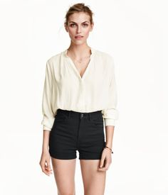 Short, 5-pocket shorts in stretch cotton-blend twill with a high waist and sewn cuffs at hems.