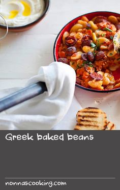 """Gigantes plaki, or """"giant beans"""", are traditionally served as part of a mezze, and this easy recipe can also satisfy as a stand-alone main. Traditionally cooked in an earthenware pot, this recipe uses petimezi to lend a gentle sweetness to the dish. Dishes Recipes, Food Dishes, Baking Recipes, Easy Recipes, Easy Meals, Greek Fish Recipe, Greek Recipes, Baked Fish, Baked Beans"""