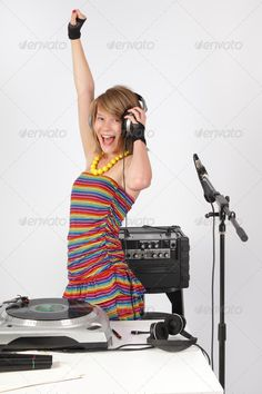 Raving deejay Dj 13 -year old girl in studio or at a disco party with equipment and a turntable shouting and having fun. http://photodune.net/item/raving-dj-girl/901706?WT.oss_phrase=turntable&WT.oss_rank=691&WT.z_author=Flemishdreams&WT.ac=search_thumb
