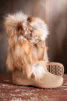 Knock 'em dead wearing these Fox Trot fox fur boots that look fantastic with skirts, leggings or jeans. Wear them après-ski or on long winter walks to stay warm, dry and chic. These soft, fluffy boots feature durable cowhide vamps, suede ties with tassels,  and thick rubber soles for great traction