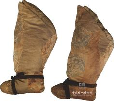 Silk boots with animal roundels Liao dynasty (916-1125)  H:29cm, Length of foot:15cm  Collection of CNSM  Accession No.  3404