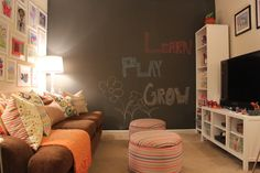 Project - Child's Play - A functional space for the kids to enjoy. Chalkboard Wall, board games, video games, movies, and lots of toys hidden away in the custom ottomans.  www.kathleenmapson.com