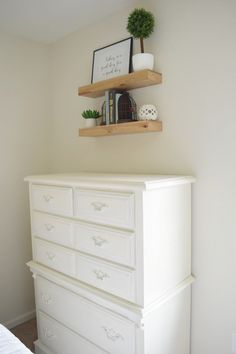 Refinished dresser in farmhouse style guest room.