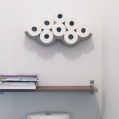 Adding poetry, humor and singularity to areas and rooms who are so often deprived of these qualities. This designer shelf, with curved, graphic and refined lines is associated with toilet paper rolls