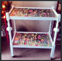 Up cycled wooden trolley. Painted and covered with floral paper.