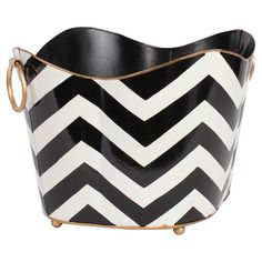 Hand-painted magazine holder with a black chevron motif and ring handles. Crafted of recycled metal.   Product: Magazine holder