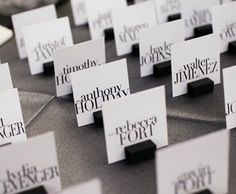 Place cards with PLUM font (could do this for cheap) numbers on the back.