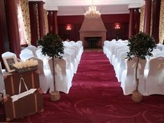 Ceremony room and Doxford Hall. Bay trees, chair covers, sashes and luggage trunks. The Garden studio www.gardenstudioevents.co.uk