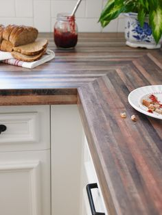 2016 Trend • Stunning Woods: Eye catching wood using contrasting colors and heavy graining continue to create drama in the kitchen. With the popularity of painted white and gray cabinets, homeowners and designers alike are free to use wood on the countertop. Oxidized and weathered woods, with their silver-gray undertones are exploding in residential applications as they work well with new grays and neutrals. Pictured here: Formica® Laminate 6318 Timberworks in Natural Grain™ Finish