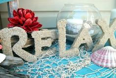 Letters covered with beach sand: http://www.completely-coastal.com/2013/09/diy-decorative-letters-beach.html