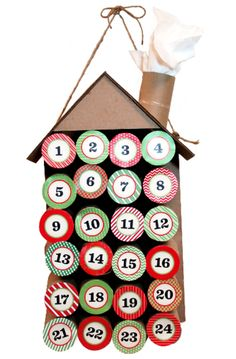 Upcycle your empty toilet paper rolls to make a creative advent calendar house.   	Download the free instructions and advent calendar numbers here