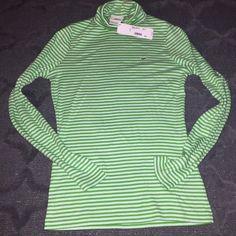 Lacoste Green Striped Turtleneck Lacoste Green Striped Turtleneck - NWT, great layering piece, fits like a Small. Lacoste Tops