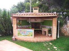 barbacoa independiente de obra con tejado de tejas