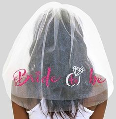 You'll definitely stand out in this pink glitter Bride to Be veil! This stunning veil is accented with a silver glitter ring! Great for a Bachelorette Party or any Wedding Event! This Veil looks great with our Bride-to-be Tiara.