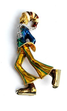 Länge: ca. 8,5 cm. Gewicht: ca. 45,4 ct. GG und WG 750. Moderne, extravagante Brosche in Form eines Eiskunstläufers, verschiedenfarbig emailliert und besetzt...