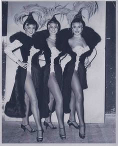 """Three of the Bluebell Girls (L-R) Susan Cartwright, Penny Parfitt, Valda Boyne Esau for the show Le Lido De Paris (Prologue of C'Est Magnifique) at the Stardust Hotel in Las Vegas, July 1958.  Image is part of UNLV Libraries """"Photo"""" digital collection."""