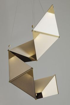 """""""Ketta is a chain of volumes that wind sculpturally in space. The individual units of Ketta were conceived as fabric covered volumes functioning like a photographer's softbox and providing a warm diffuse light"""" - JAMES DIETER - (Ketta pendant Lamp by James Dieter)"""
