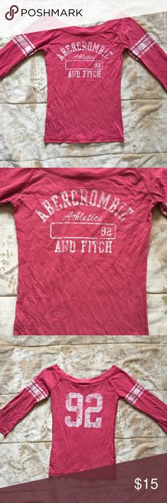Abercrombie Pink and White Off the Shoulder Top Pink and white long sleeved top that sits off the shoulder. Number 92 on the back.  60% cotton, 40% polyester. Gently used and in good condition. Abercrombie & Fitch Tops