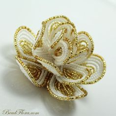 Brides hair fascinator clip,  French beaded flower Golden Goddess , weddings, prom, parties. $78.00, via Etsy.
