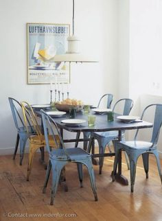Blue chairs / yellow chair / print / dining room