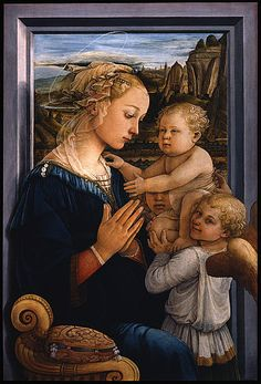 """Madonna and Child"" c.1465 by Filippo Lippi (Florence c.1406 - Spoleto 1469). Tempera on panel (92x63cm). Ufizzi Gallery. Quattrocento. The Madonna is identified with Lucrezia Buti (nun and lover of Lippi), during the Prato period (1452-1466). The work is unusual, placed in front of an open window (inspired to Flemish painting). Unlike previous works, the Child is held by two angels, one of which, smiles towards the observer. The work was an influential model for later depictions…"