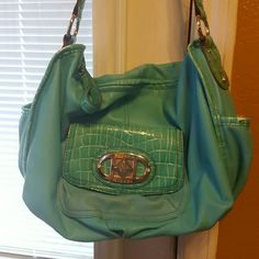 Turquoise Shoulder Bag Several Flaws but still a good bag! Several Pockets! Stains on the inside but not noticeable.  10in High  14.5in Long Sienna Ricchi Bags Shoulder Bags