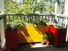 old filing cabinets + a coat of glossy, bright paint = lovely, cheap planters (via Apartment Therapy)