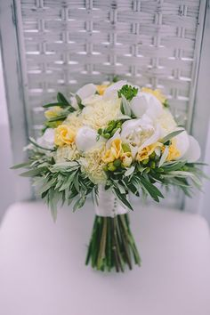 Beautiful Wedding Bouquet Showcasing: White Peonies, White Carnations, White Roses, Yellow Freesia, Greenery & Foliage