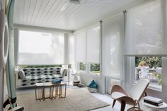 White solar shades can adopt the color of their surroundings, and soften the visual impact of a view.