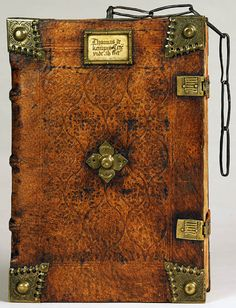 Thomas A. Kempis. Opera, Nuremburg, 1494. Folger Shakespeare Library. This volume is one of a very few existing examples of a chain binding. It still retains the remnant of the hand-wrought chain that secured it to the shelf.