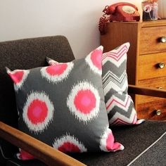 Pink and grey ikat print cushion cover by Black Eyed Susie