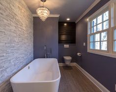 Stacked-stone tile looks amazing in a bathroom, especially when washed with light. Here's what to think about before you buy