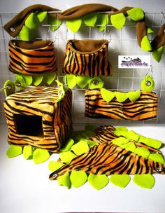 Pretty cool jungle fleece cage set for small pets with hammocks, hideouts and snuggle sacks.