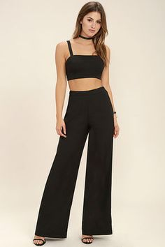 You'll be the queen of the VIP in the Koko Black Two-Piece Jumpsuit! Woven fabric shapes this sleek and sexy set that includes a darted crop top with a square neckline and lace-up back. Matching high-waisted trousers have wide pant legs and elastic at back, plus a hidden side zipper/clasp.