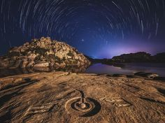 Celestial SpinPhotograph by Alexander Grabchilevhttp://photography.nationalgeographic.com/photography/photo-of-the-day/hampi-star-trails/