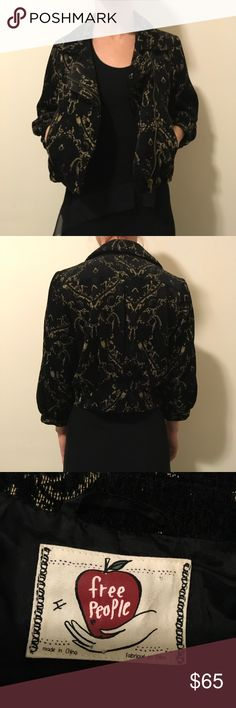 FREE PEOPLE Black Deco Print Cropped Moto Jacket Free People black brocade like deco printed jacket with a cropped bottom and a moto style zipper closure in the front with a high collar that lays flat also. Super soft and sleeves are just under the elbows. Two front pockets. Size 4. In good condition!! Free People Jackets & Coats
