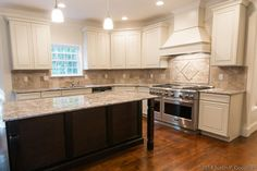 Traditional Kitchen with Complex granite counters, Hardwood floors, Custom hood, Limestone Tile, Ceramic Tile, L-shaped