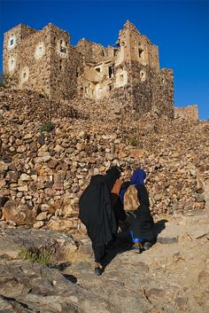 Young veiled girls heading for school in the mountaintop village of Shihara, Yemen by Phil Marion